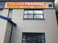 Toland Training logo